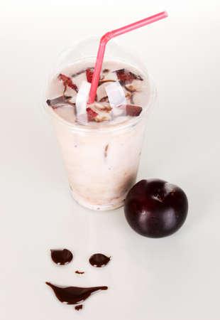 Delicious milk shake with fruit isolated on white photo