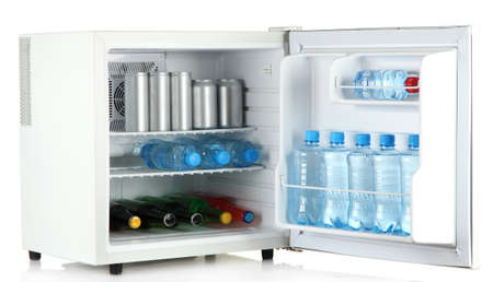 mini fridge full of bottles and jars with various drinks isolated on white Stock Photo - 14906648