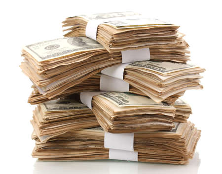 stacks of money: Stack of one hundred dollars banknotes close-up isolated on white