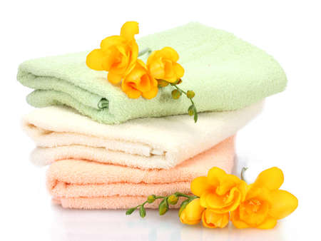 colorful towels and flowers isolated on white Stock Photo