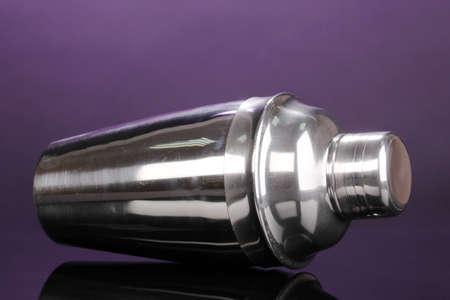 Cocktail shaker on violet background Stock Photo - 14907088