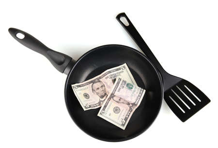 Banknotes in a frying pan with cooking spatula isolated on white Stock Photo - 14906983