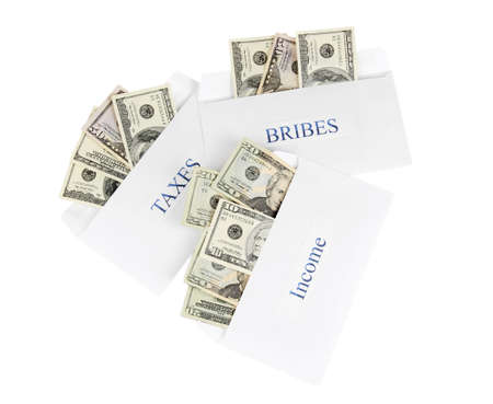 bribes: The envelopes with the money bills isolated on white