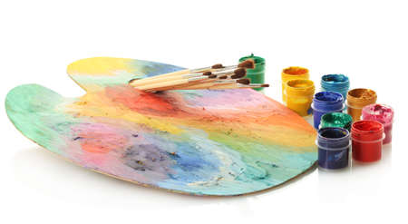 wooden art palette with paint and brushes isolated on white Stock Photo - 14906946