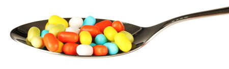colorful pills on spoon on white background close-up Stock Photo - 14906827