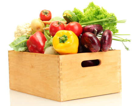 Fresh vegetables in wooden box isolated on white photo