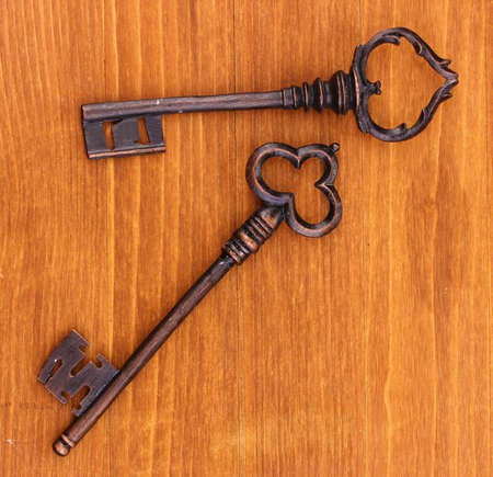 Two antique keys on wooden background Stock Photo - 14954773