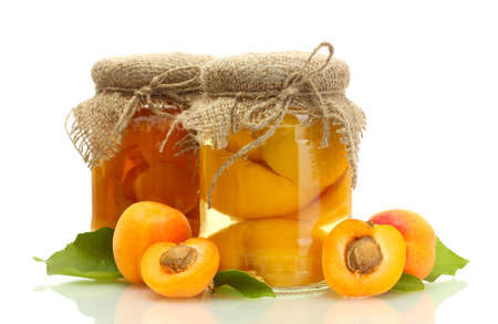 canned apricots in a jars and sweet apricots isolated on white photo