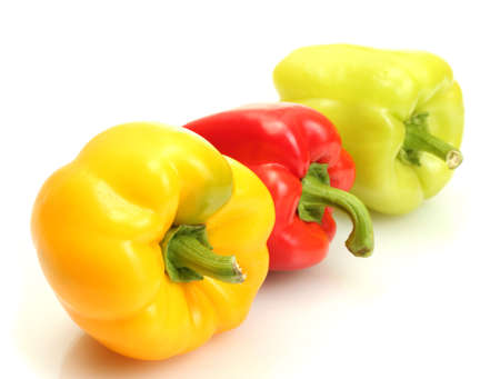 fresh yellow, red and green bell peppers isolated on white photo