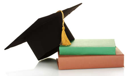 alumna: Grad hat and diploma with books isolated on white Stock Photo