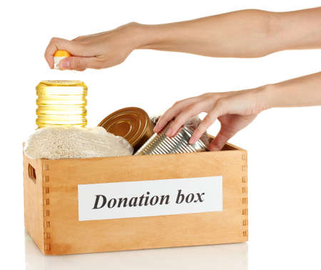 Donation box with food on white background close-up Stock Photo - 14942952
