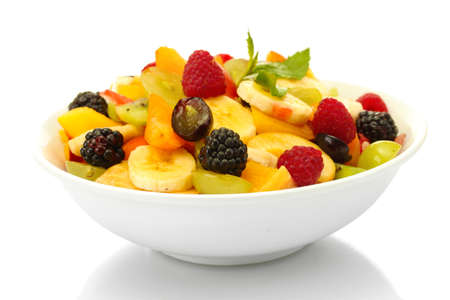 fresh fruits salad in bowl, isolated on white photo