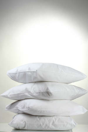 white pillow: pillows, on grey background Stock Photo