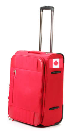 red suitcase with sticker with flag of Canada isolated on white Stock Photo - 14943344