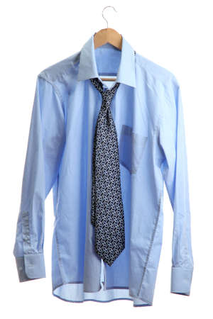 blue shirt with tie on wooden hanger isolated on white Stock Photo - 15216600