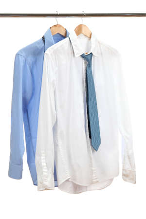 clothing rack: blue and white shirts with tie on wooden hanger isolated on white