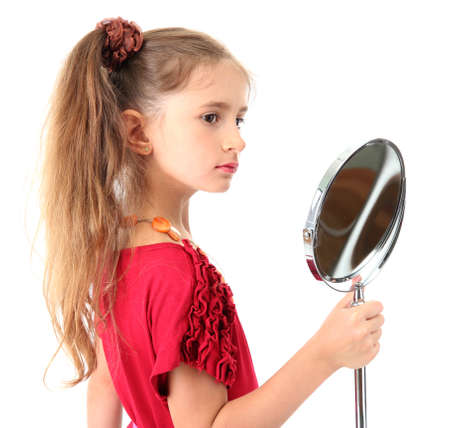 little girl in her mother's dress and mirror, isolated on white Stock Photo - 15741271