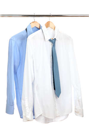 mens: blue and white shirts with tie on wooden hanger isolated on white