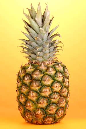 pineapple on orange background photo
