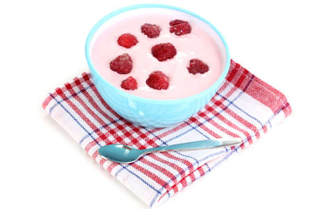 Yogurt with raspberries isolated on white photo