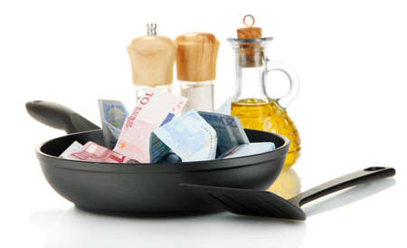 Banknotes in a frying pan with cooking spatula isolated on white Stock Photo - 15018248