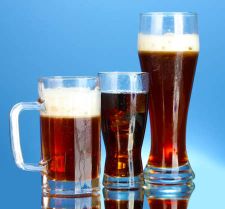 refreshments - beer, cola and kvass on blue background photo