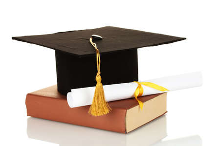 alumna: Grad hat and diploma with book isolated on white Stock Photo
