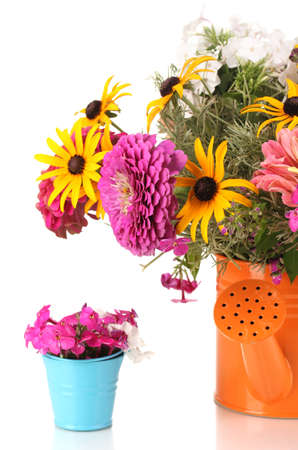 bailer: Beautiful bouquet of bright flowers in bailer isolated on white
