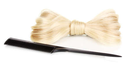 Shiny blond hair-pin and comb isolated on white Stock Photo - 15066554