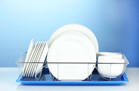 clean dishes: clean dishes on stand on blue background