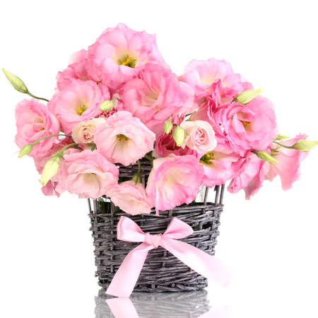 bouquet of eustoma flowers in  wicker vase, isolated on white photo
