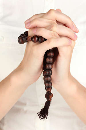 payer: Hands in Prayer with Crucifix close-up