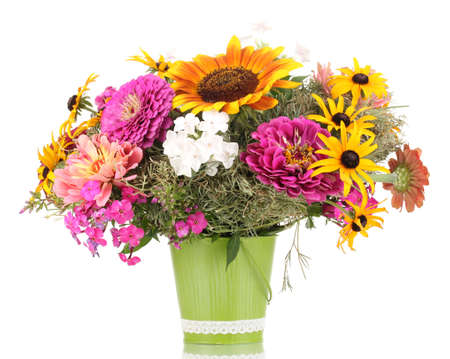 Beautiful bouquet of bright flowers in pail isolated on white photo