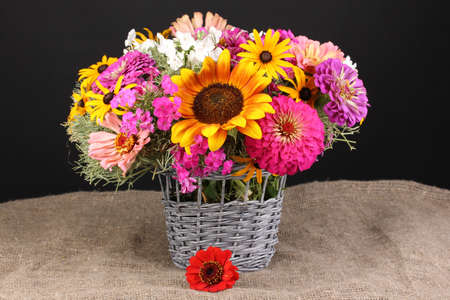 ronantic: Beautiful bouquet of bright flowers on sacking on black background