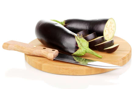 Sliced eggplant on chopping board isolated on white photo