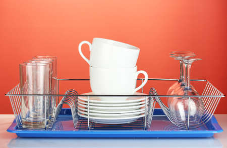 clean dishes: clean dishes on stand on red background