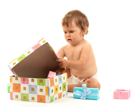 Cute baby and gift box isolated on white photo