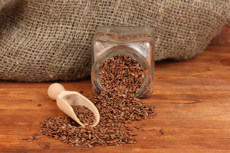 Flax seeds in wooden spoon on wooden background close-up Stock Photo - 15105183