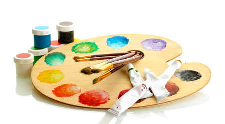 wooden art palette with paint and brushes isolated on white Stock Photo - 15104502