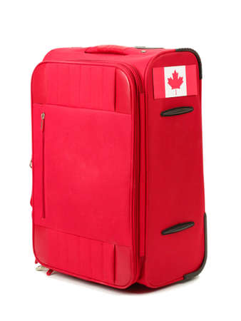 red suitcase with sticker with flag of Canada isolated on white photo