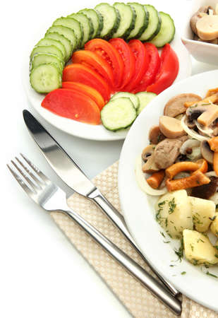Roast chicken cutlet with boiled potatoes and  mushrooms on plate, isolated on white photo