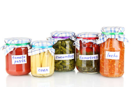 Jars with canned vegetables isolated on white photo