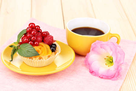 Dulcet cake with fruit and berries on wooden table photo