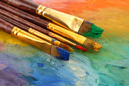 acrylic paint and brushes on wooden palette Stock Photo - 15153239
