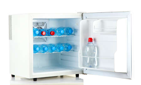 mini fridge full of bottled water isolated on white photo