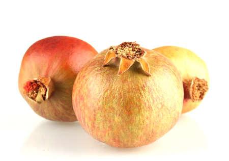 unripe: unripe pomegranates isolated on white