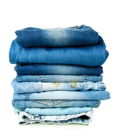 Lot of different blue jeans isolated on white Stock Photo - 15153208