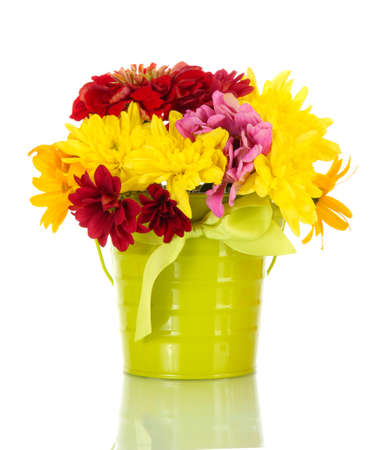 bouquet of beautiful summer flowers in bucket, isolated on white photo