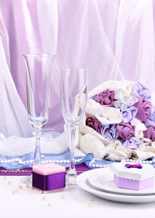 a frill: Serving fabulous wedding table in purple color on white fabric background Stock Photo