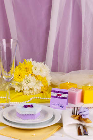 a frill: Serving fabulous wedding table in purple and yellow color on white and purple fabric background